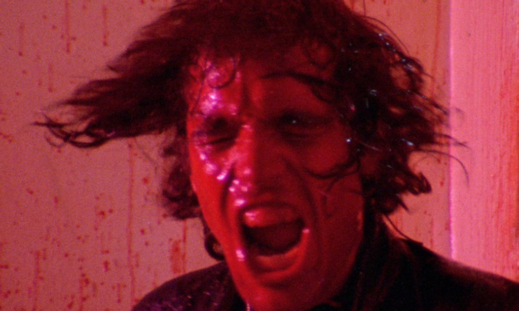 Abel Ferrara playing Reno Miller drenched in blood from the movie The Driller Killer